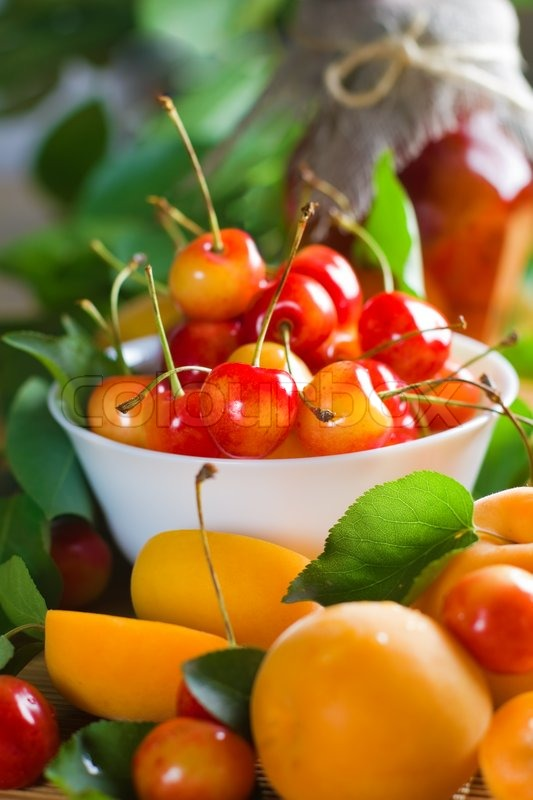 Apricots and sweet cherry with leaves   Stock Photo ...