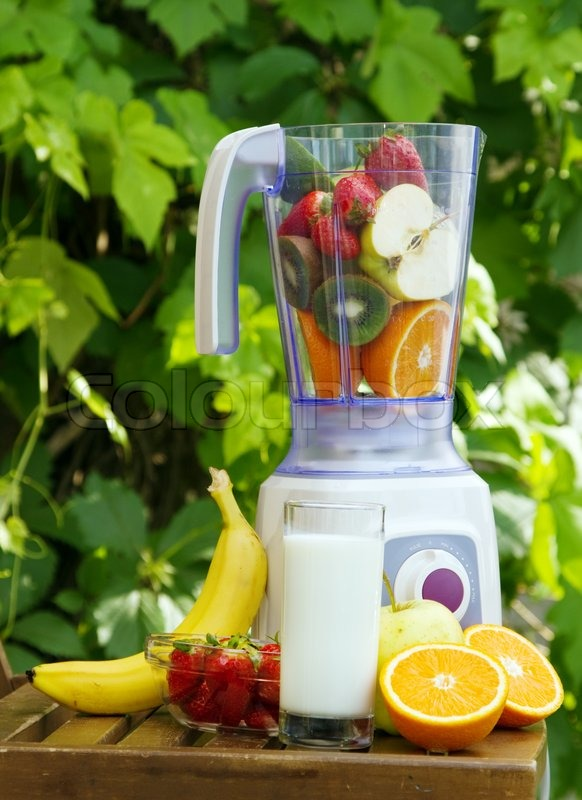 Electric blender with fruits in it, stock photo