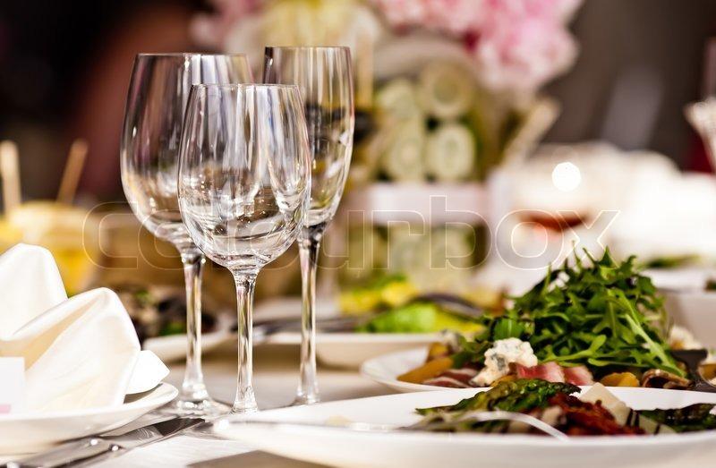 Empty glasses set in restaurant, stock photo
