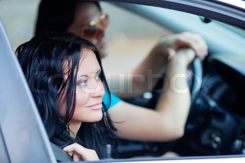 Woman and man in the car, stock photo