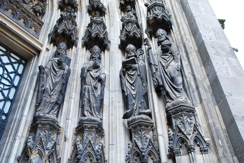 Sculpture Under Gate Of Cologne Cathedral Stock Photo