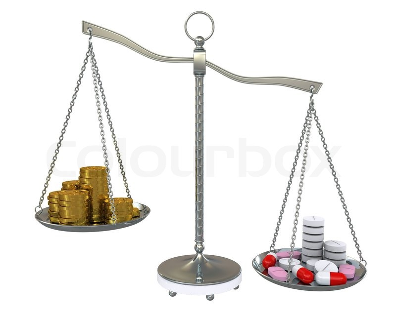 Money and pills in the gold balance scales. Isolated on ...