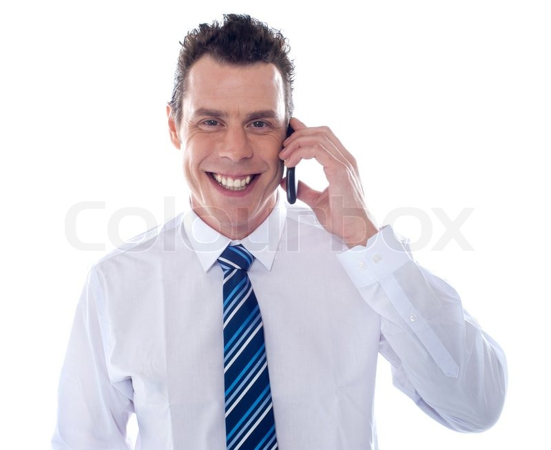 Smiling businessman attending phone call | Stock Photo ...