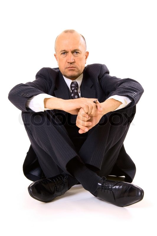 businessman sitting on the floor stock photo colourbox. Black Bedroom Furniture Sets. Home Design Ideas