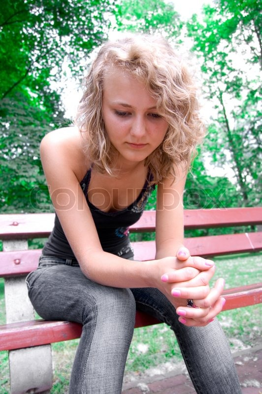 Young Depressed Girl Sitting On A Park Stock Photo Colourbox