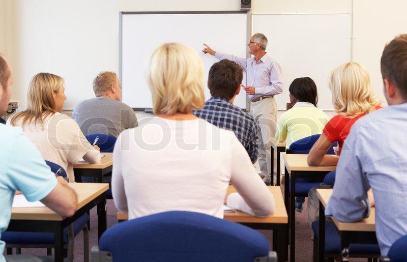 Senior tutor teaching class, stock photo