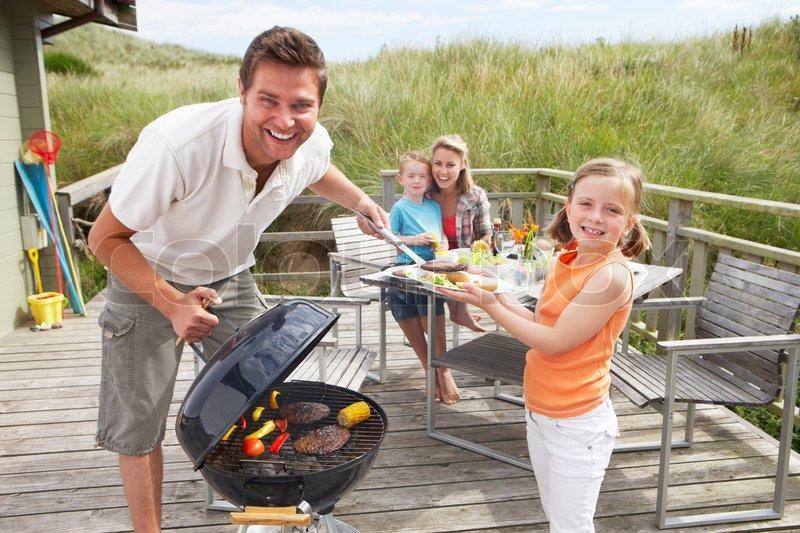 Family On Vacation Having Barbecue Stock Photo Colourbox