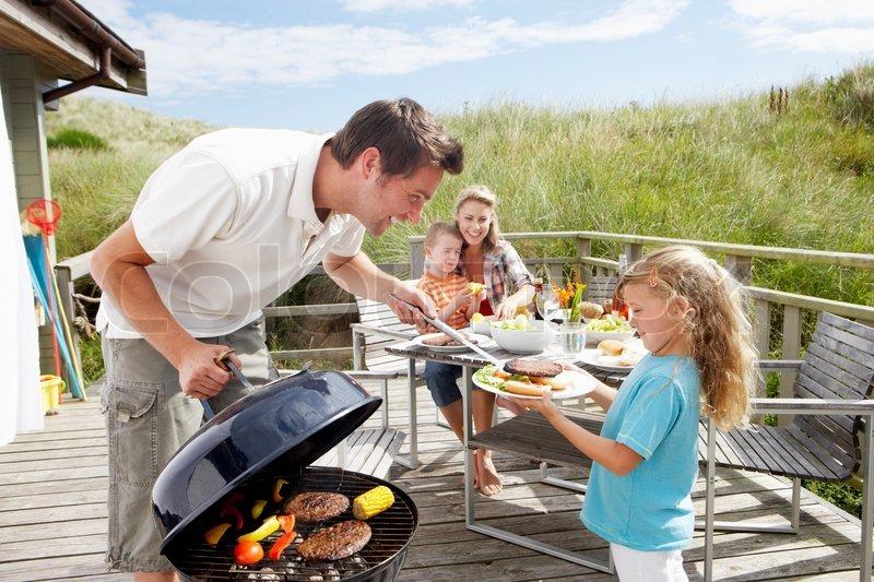 Family on vacation having barbecue stock photo colourbox - La casa del barbecue ...