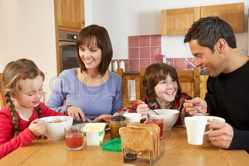 Family Eating Breakfast Together In Kitchen   Stock Photo ...