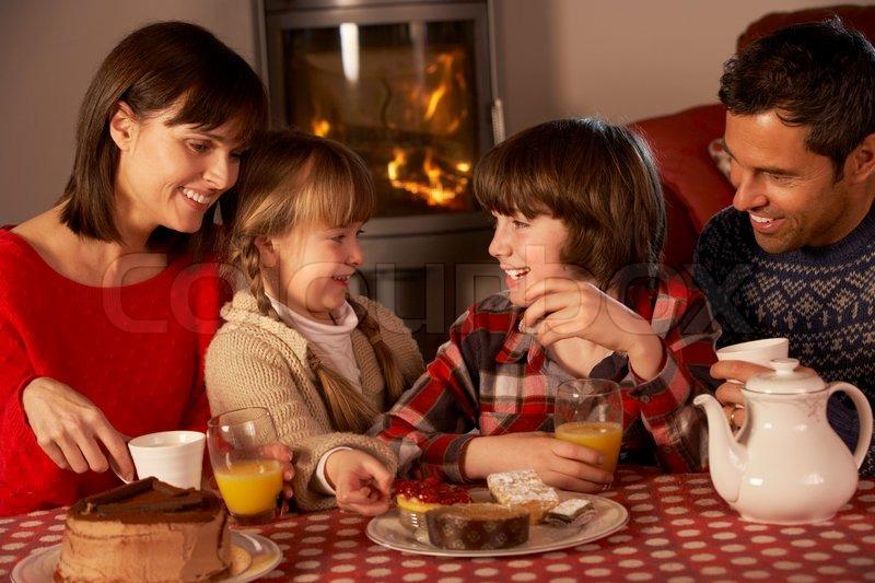 Portrait Of Family Enjoying Tea And Stock Photo
