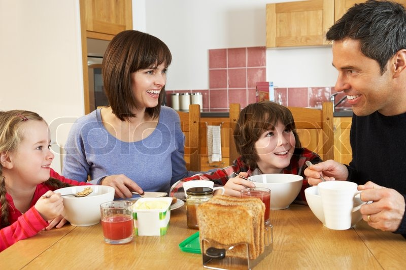 Family Eating Breakfast Together In Kitchen | Stock Photo ...
