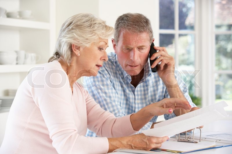 Retired Couple With Household Bills Stock Photo Colourbox