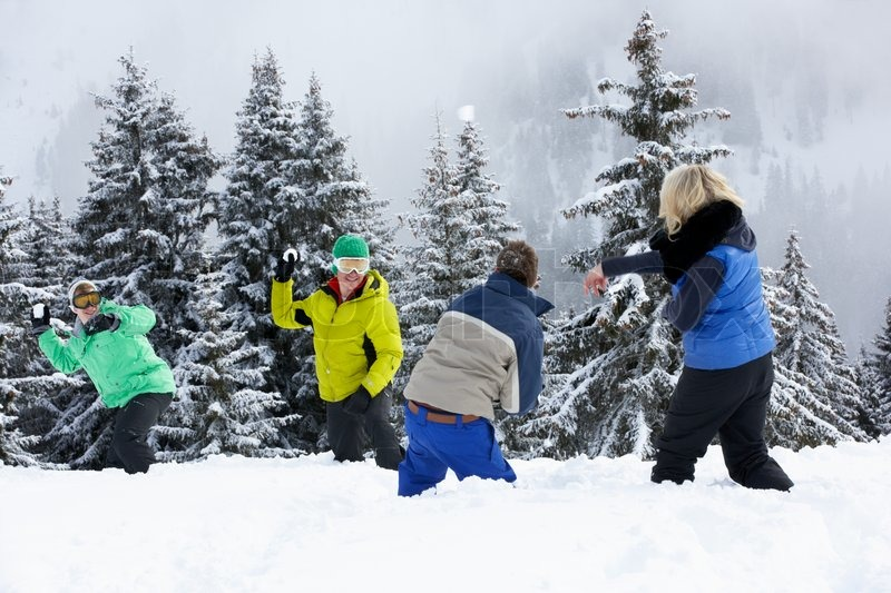 Group Of Young Friends Having Snowball Fight On Ski