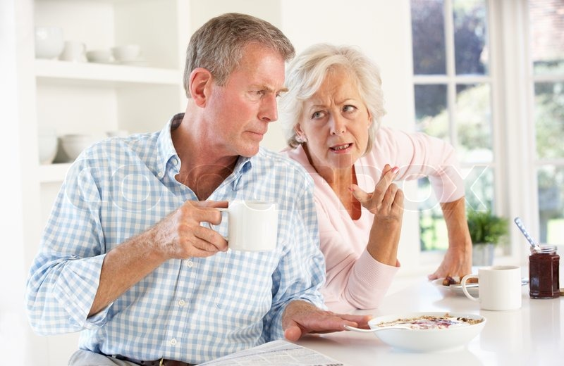 Retired Couple Arguing At Breakfast Stock Photo Colourbox