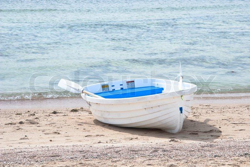 Wooden fishing boat on the sea beach | Stock Photo | Colourbox