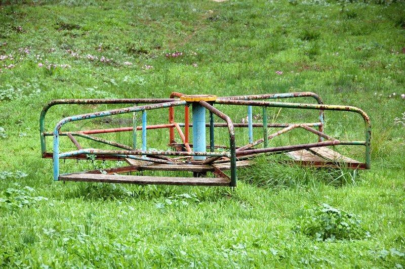 Vintage rusty merry-go-round Abandoned playground | Stock ...