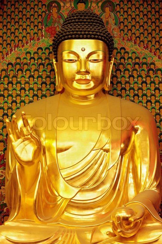 statue of gold buddha stock photo colourbox