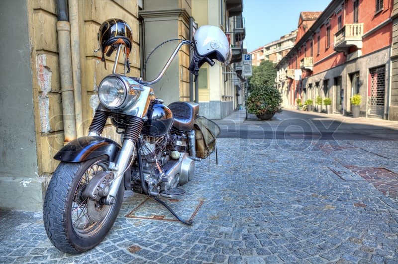 motorcycle on the street alba italy stock photo colourbox. Black Bedroom Furniture Sets. Home Design Ideas