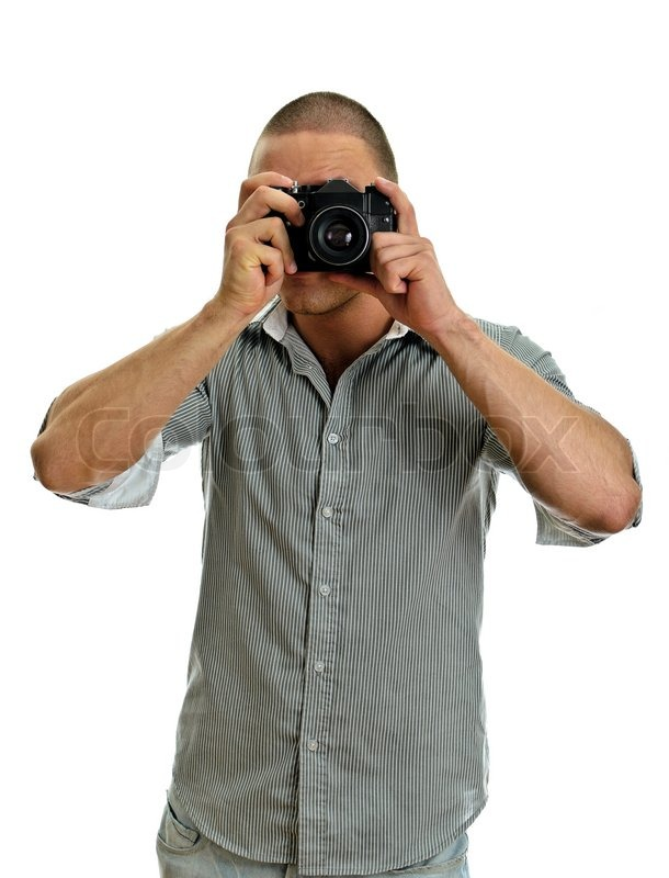 Man taking pictures with retro camera isolated on white stock photo