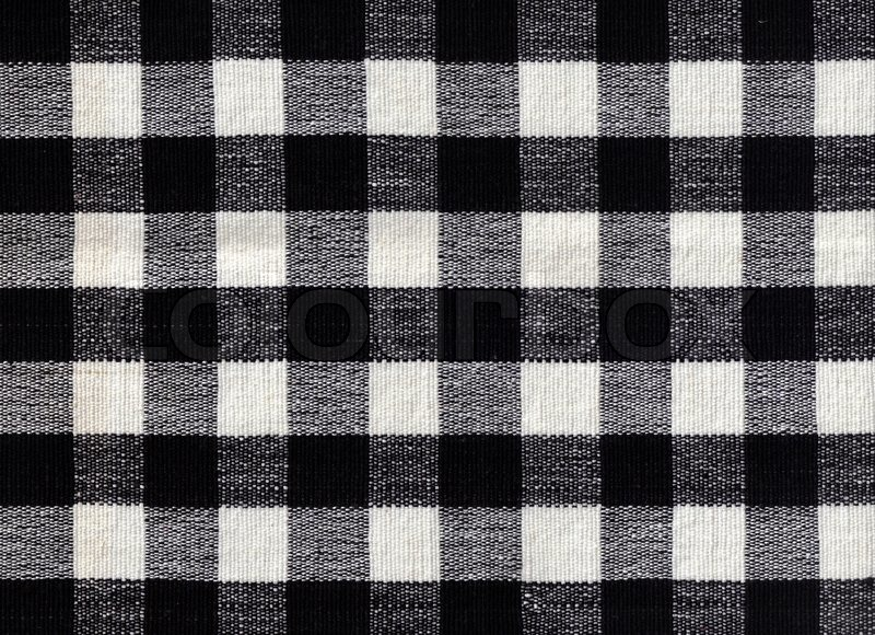 Black and white checked fabric background, stock photo