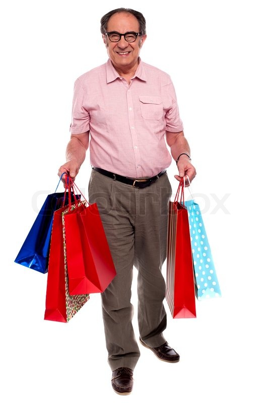 Happy matured man carrying shopping bags | Stock Photo | Colourbox