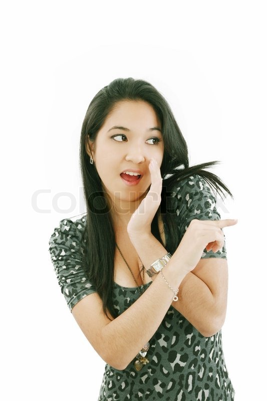 beautiful woman laughing and pointing at someone stock