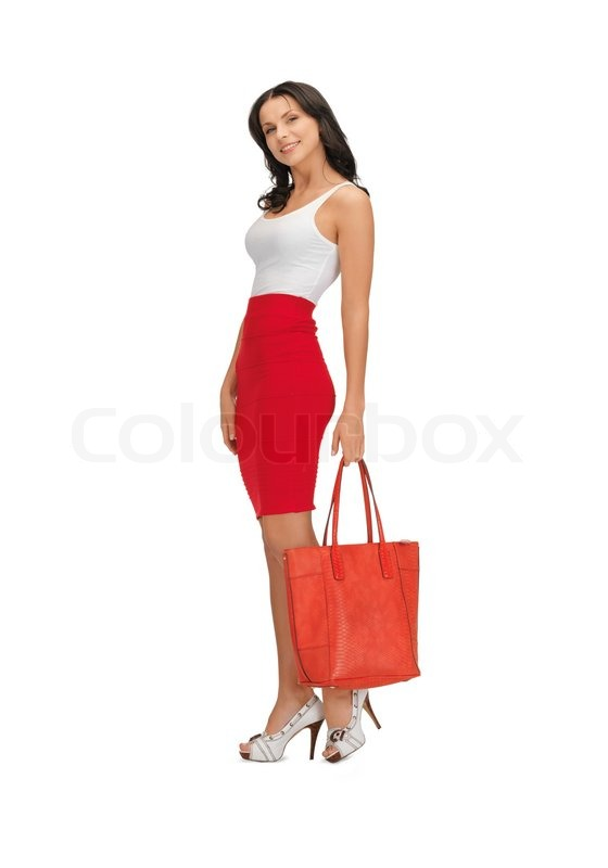 Woman in dress with a bag | Stock Photo | Colourbox