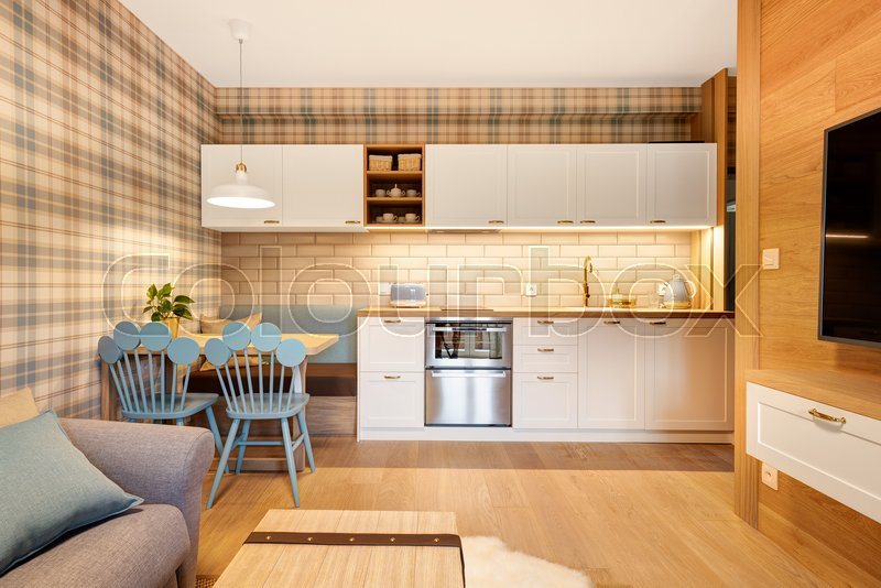 Kitchen with wood paneled apartment ...