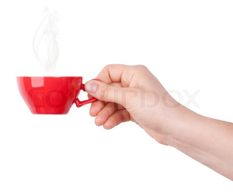 red cup of tea or coffee in hand stock photo colourbox
