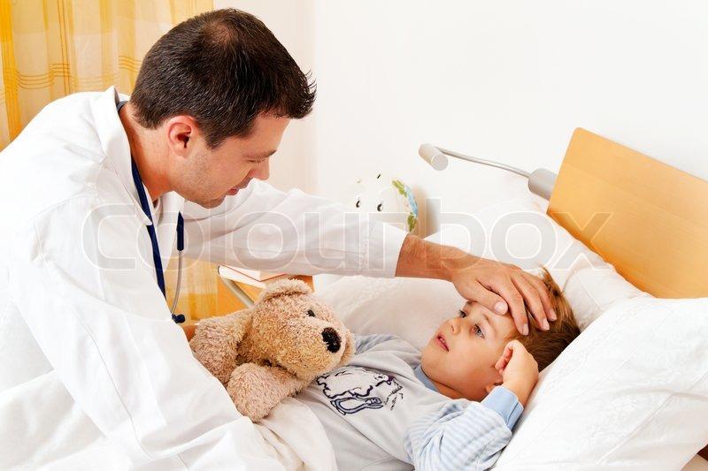 Doctor house call examines sick child, stock photo
