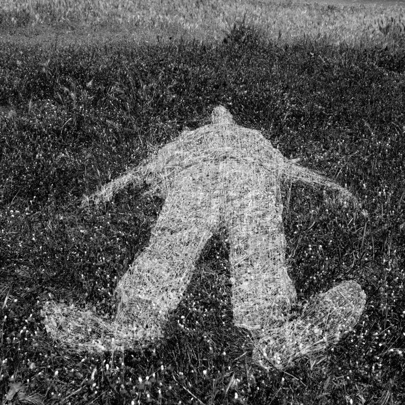 Human Figure Outline Imprinted On Grass Stock Photo