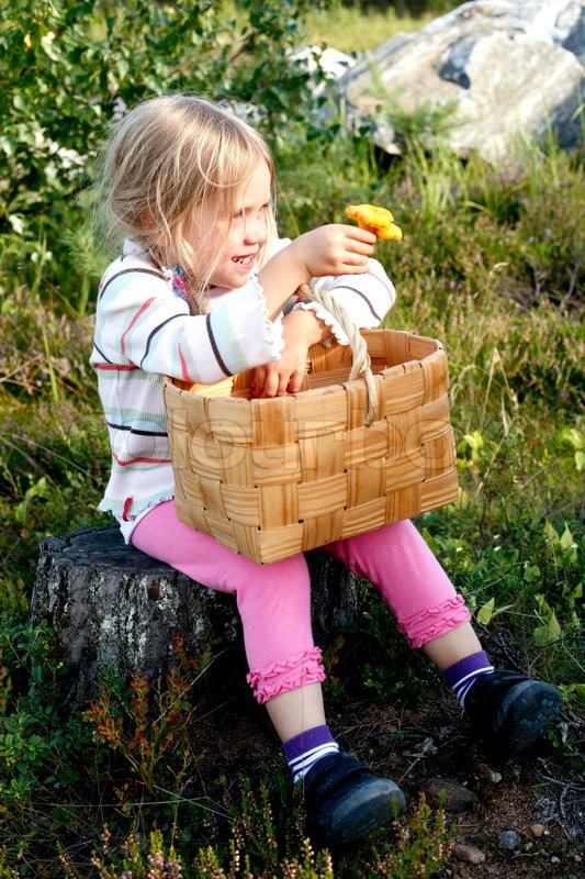 https://www.colourbox.com/preview/4398202-smiling-little-mushroom-collecting-girl-sitting-in-the-forest-showing-a-yellow-chanterelle.jpg