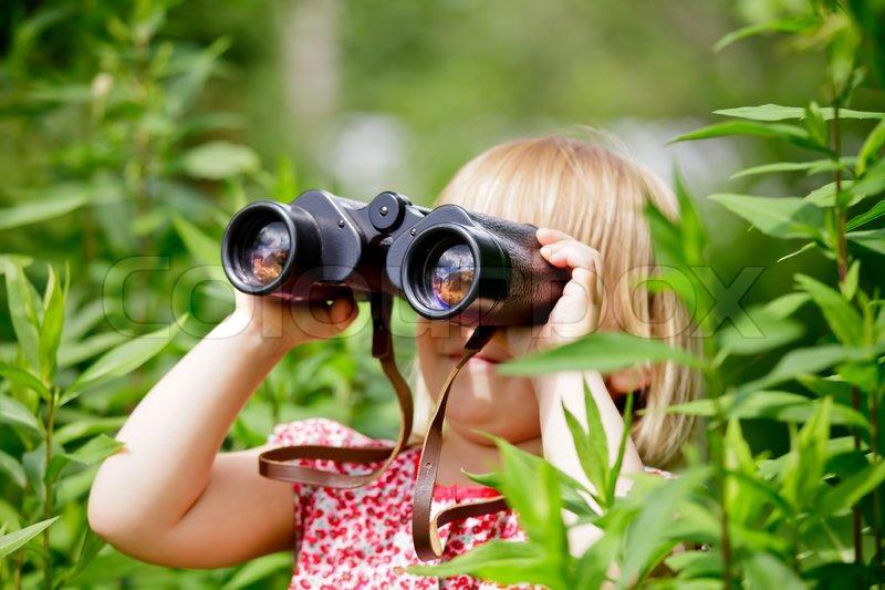 Child Looking Through Binoculars Stock Photo Colourbox