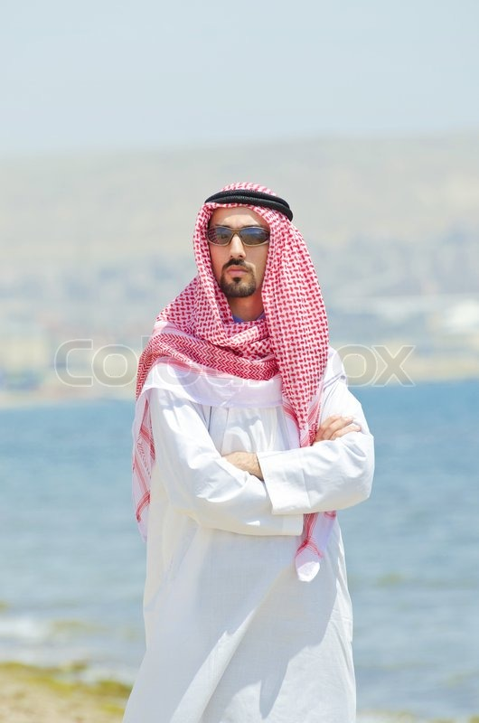 Arab on seaside in traditional clothing | Stock Photo ...