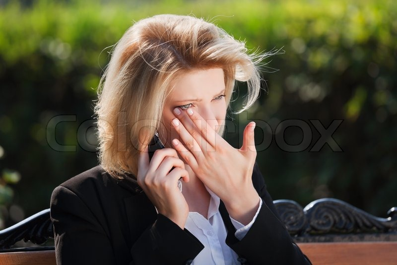 Sad Woman Calling On The Phone Stock Photo Colourbox