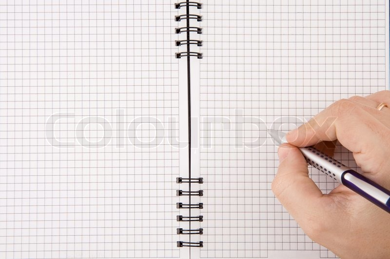 Hand writing by pen on notebook, stock photo