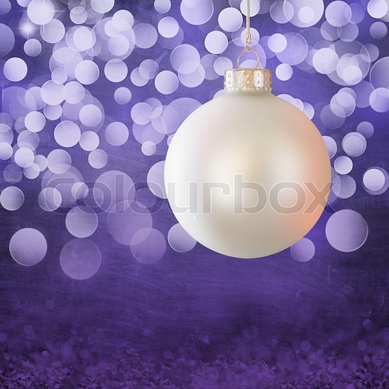White Vintage Christmas Ball Ornament Over Elegant Purple Light Bokeh Snow Crystal Grunge Background
