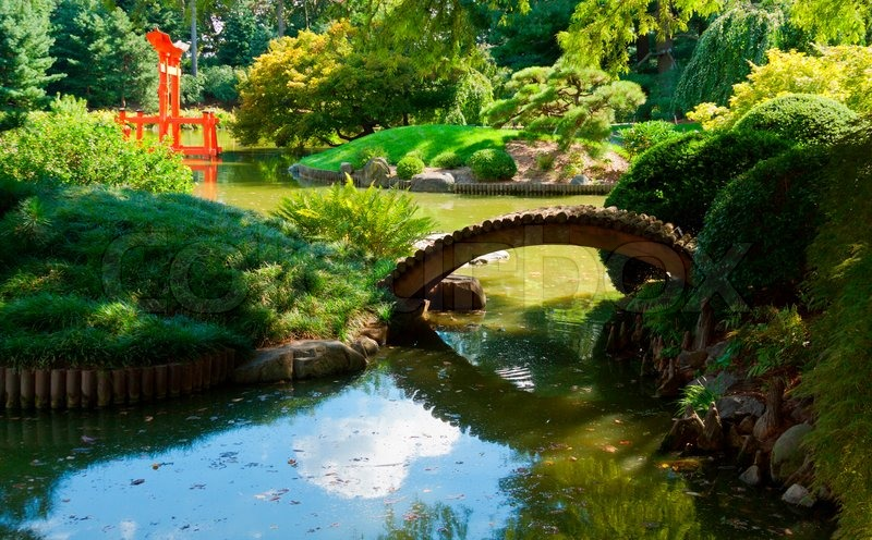 Japanese garden and pond with a red zen tower stock for Garden pool zen area