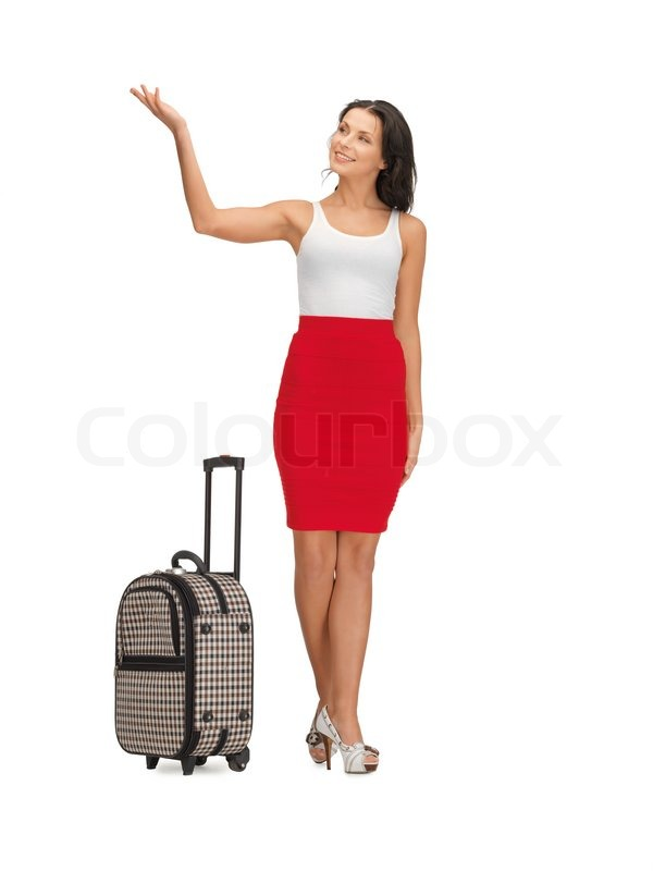 Happy woman with suitcase greeting | Stock Photo | Colourbox