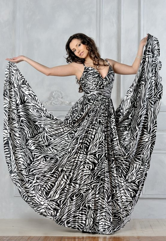 Beautiful Woman In A Very Long Dress With Zebra Printing Stock