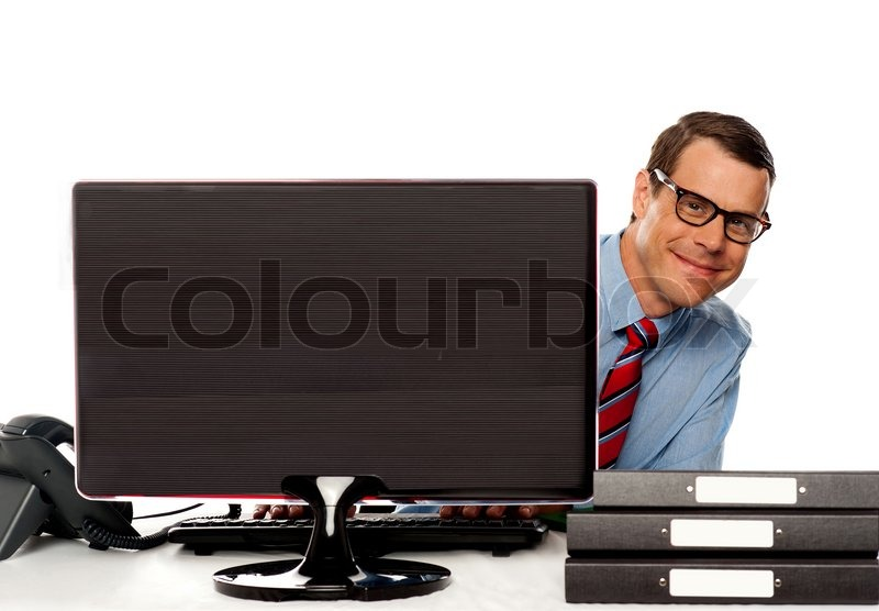 man peeping from behind computer screen stock photo colourbox