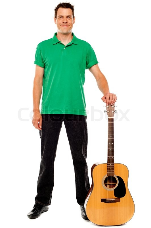 Young Guitarist Standing With Guitar