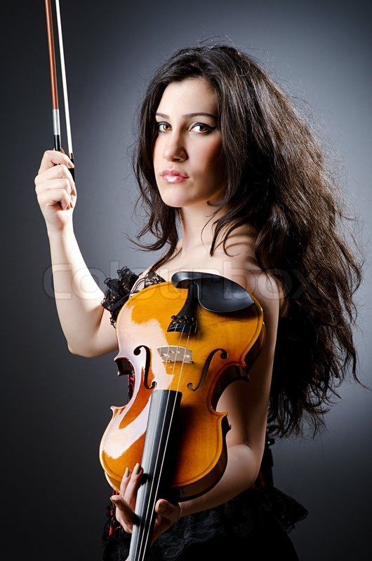 Female Violin Player Against Background Stock Photo