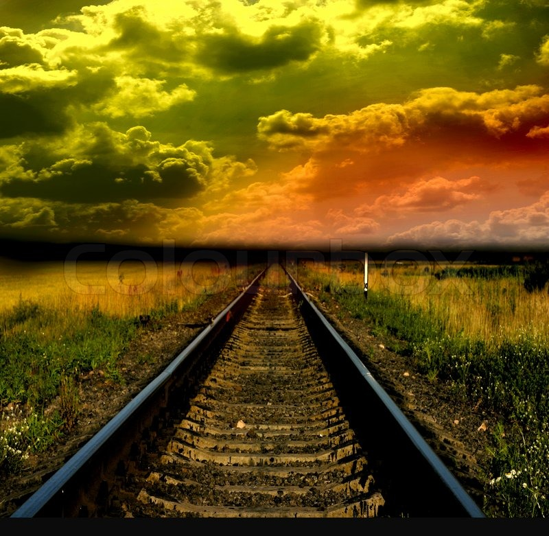 Stock image of 'Old railway to sunset'