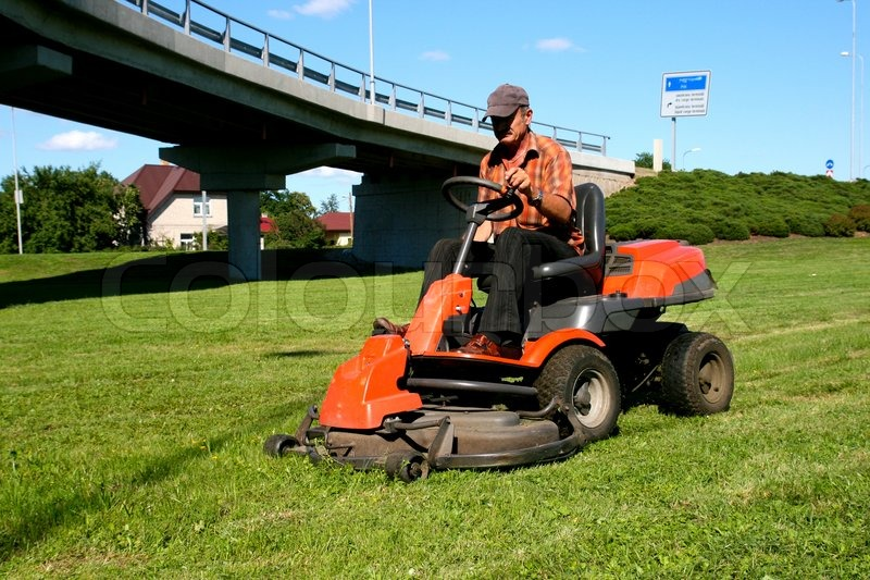 Man On Tractor Lawn Enforcment : Man on a lawn tractor stock photo colourbox