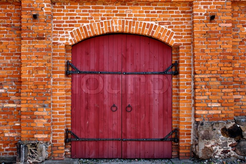 & Red door in red brick wall | Stock Photo | Colourbox