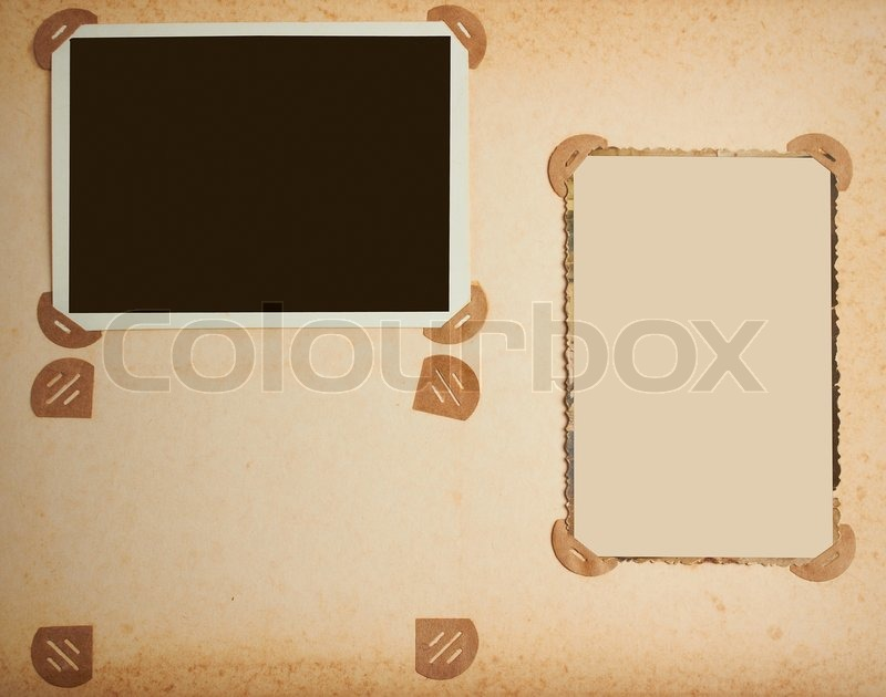 Stock image of 'Old-fashioned photo frames in vintage album'