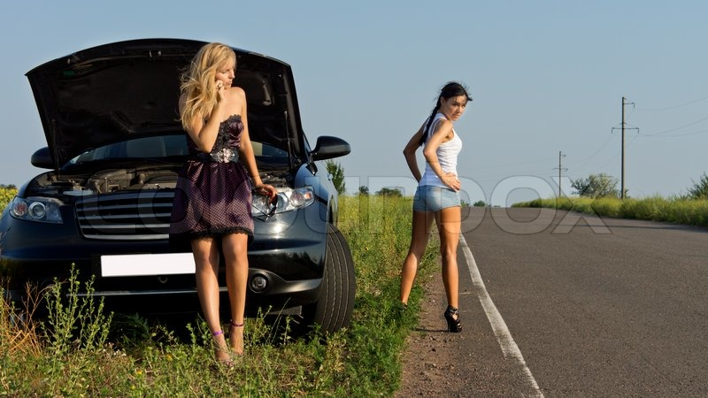 two girls wait for the help on the road stock photo colourbox. Black Bedroom Furniture Sets. Home Design Ideas