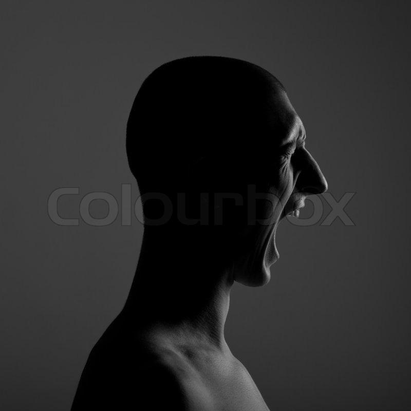Portrait Of A Screaming Man. Low-key Lighting