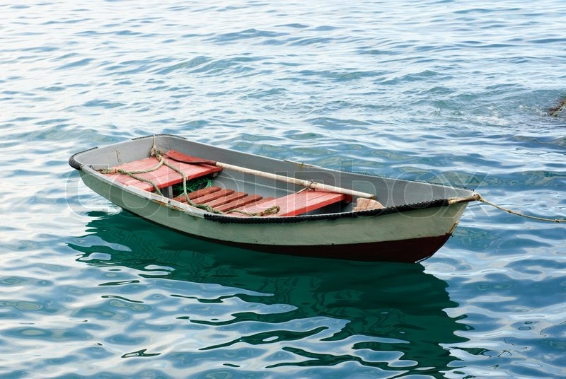 Lifeboat with paddle Old wooden boat | Stock Photo | Colourbox
